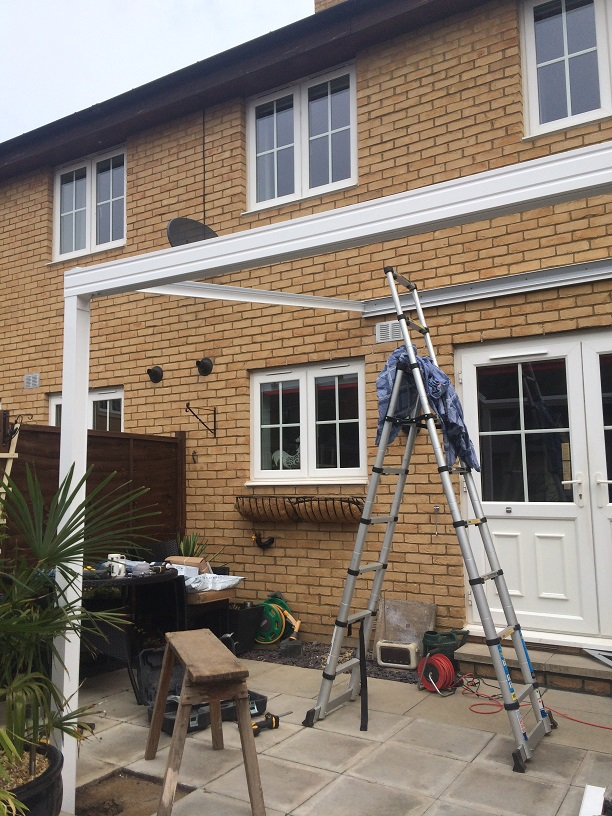 Stages of garden canopy fitting LuMac Canopies