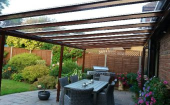 brown canopy, back garden, BBQ, block pave patio