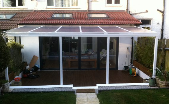 clear canopy, decking, outdoor area.