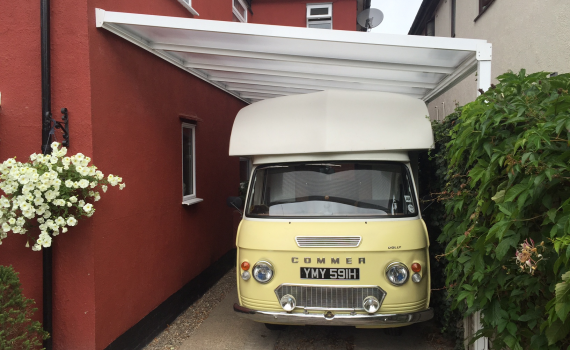 classic camper, carport, driveway